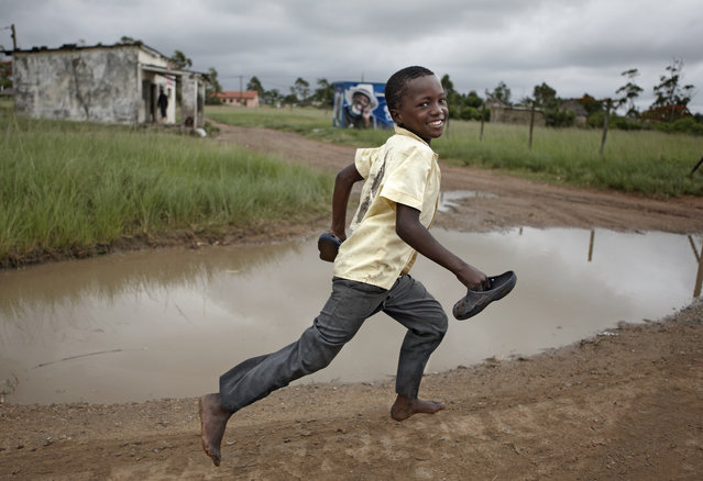 """""""Orphan Race"""". We were running from the Common Threadz orphanage to the Futbol field in Obenjeni South Africa. Photo location: Kwazulu Natal, South Africa. (Photo and caption by Kenneth Harris/National Geographic Photo Contest)"""
