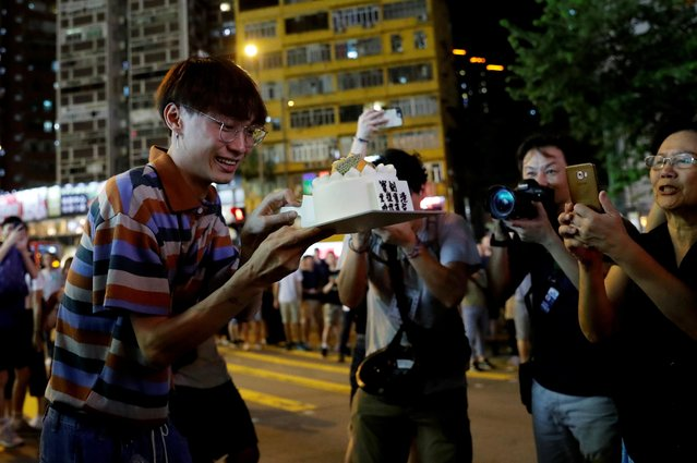 A man celebrates his birthday during a protest near Mong Kok police station in Hong Kong, September 7, 2019. (Photo by Tyrone Siu/Reuters)