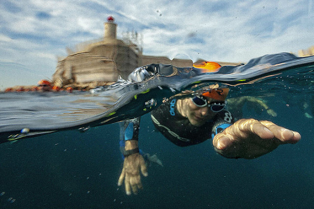 A swimmer competes in Le Defi Monte-Cristo (Monte Cristo Challenge) swimming event at the Chateau d'If, off the coast of Marseille, southern France, on June 21, 2019. Created in 1999 and inspired by Alexandre Dumas' character of Edmond Dantes, the Monte Cristo Challenge will take place from June 21 to 23, 2019. (Photo by Boris Horvat/AFP Photo)