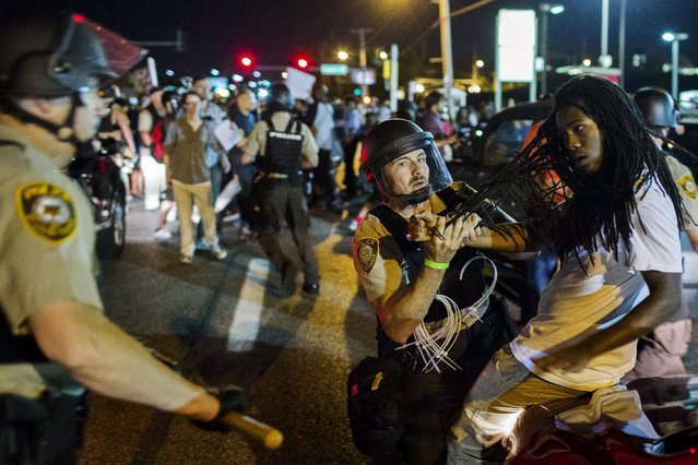 St Louis County police officers arrest an anti-police demonstrator in Ferguson, Missouri August 10, 2015. (Photo by Lucas Jackson/Reuters)