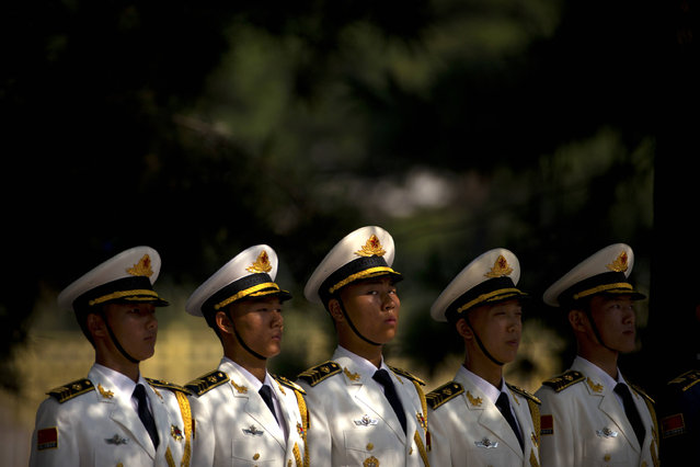 Chinese honor guard members line up in formation before a welcoming ceremony for Russian President Vladimir Putin at the Great Hall of the People in Beijing, Saturday, June 25, 2016. (Photo by Mark Schiefelbein/AP Photo)