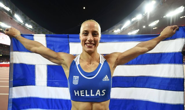 Second placed Nikoleta Kyriakopoulou of Greece celebrates with her national flag after the women's pole vault final at the 15th IAAF World Championships at the National Stadium in Beijing, China, August 26, 2015. (Photo by Dylan Martinez/Reuters)