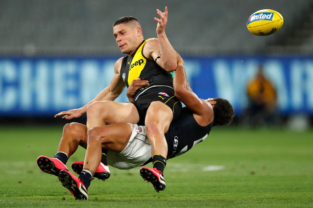 Dion Prestia of the Tigers is tackled by Sam Petrevski-Seton of the Blues during the 2020 AFL Round 01 match between the Richmond Tigers and the Carlton Blues at the Melbourne Cricket Ground on March 19, 2020 in Melbourne, Australia. (Photo by Dylan Burns/AFL Photos via Getty Images)