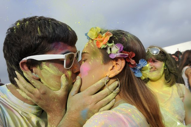 Revellers take part in the Holi Party Festival at the Niemeyer Center in Aviles, northern Spain, August 29, 2015. (Photo by Eloy Alonso/Reuters)