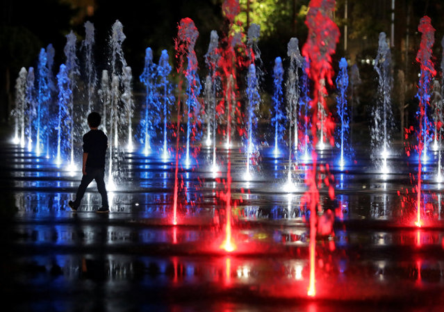 A child walks through the colour lit fountain in Nice, France, September 20, 2017. (Photo by Eric Gaillard/Reuters)