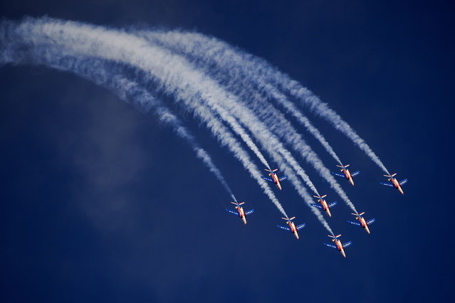 "Jets of the ""The Patrouille de France"" perform during the first day of AIR14 airshow on August 30, 2014 in Payerne, western Switzerland. The airshow commemorates over two weenk-ends the 100th anniversary of the Swiss Air Forces. (Photo by Fabrice Coffrini/AFP Photo)"