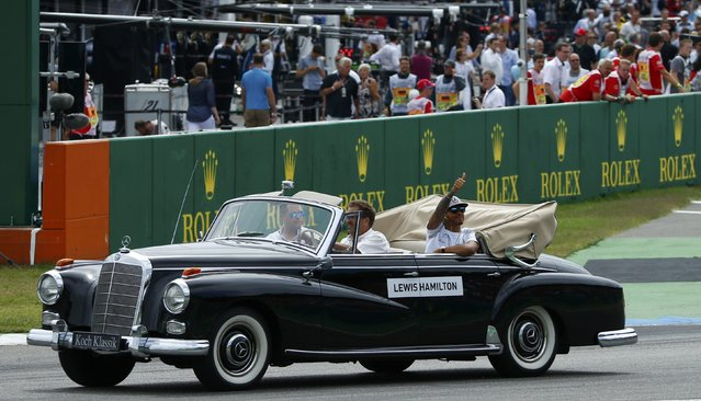 Germany Formula One, F1, German Grand Prix 2016, Hockenheimring, Germany on July 31, 2016. Mercedes' Lewis Hamilton waves during the drivers' parade. (Photo by Ralph Orlowski/Reuters)