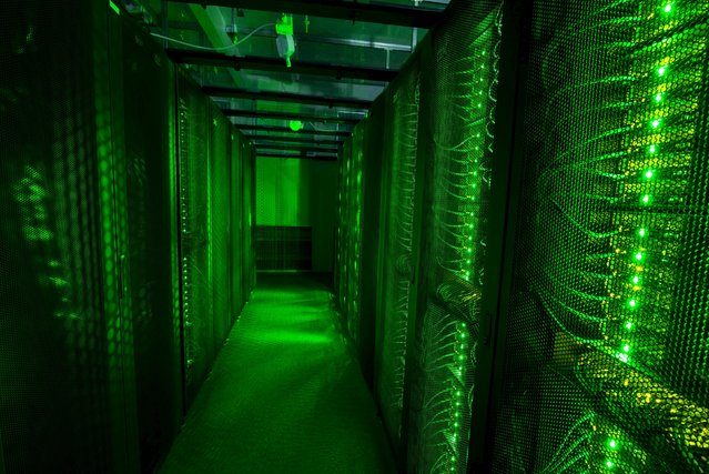 Servers for data storage are seen at Advania's Thor Data Center in Hafnarfjordur, Iceland August 7, 2015. As it emerges from financial isolation, Iceland is trying to make a name for itself again, this time in the business of data centres – warehouses that consume enormous amounts of energy to store the information of 3.2 billion internet users. (Photo by Sigtryggur Ari/Reuters)
