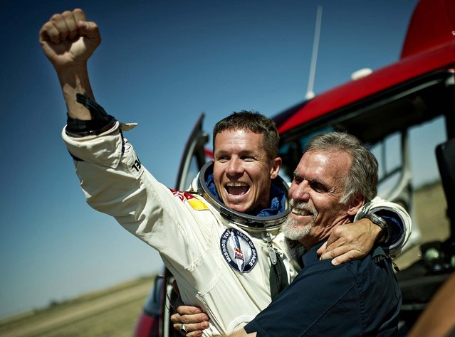 Baumgartner and Technical Project Director Art Thompson embrace after successfully completing the final manned flight for Red Bull Stratos in Roswell. (Photo by Joerg Mitter/Red Bull Stratos)
