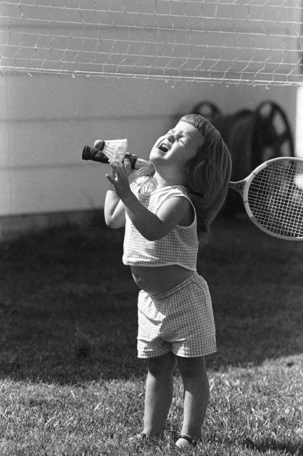 The game of badminton, which is too vigorous even for some of the older set, was found to be a bit too speedy for two-year-old beginner Rhonda Duckett who took racquet in hand for the first time, July 12, 1965 in Marion, Indiana. The shuttlecock bounces off her head as she fails to return a serve. (Photo by Bob Daugherty/AP Photo)