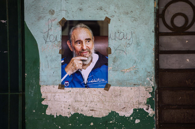 A poster of Cuban Revolution leader Fidel Castro is seen on a wall in Havana, Cuba, Saturday, August 13, 2016. As Castro celebrates his 90th birthday, the Cuban government has taken a low-key approach to Castro's birthday. There are no massive rallies or parades planned, no publicly announced visits from global dignitaries. (Photo by Desmond Boylan/AP Photo)