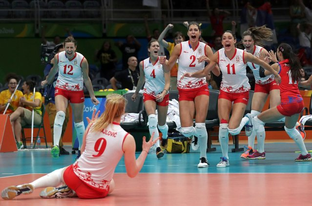 Serbian team players celebrate their defeat of the US team in women's volleyball, August 18, 2016. (Photo by Ricardo Moraes/Reuters)
