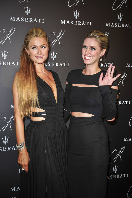 Paris Hilton,left, and Nicky Hilton pose at Carine Roitfeld & Stephen Gan celebration of the launch of CR Fashion Book N.5 in Paris, Tuesday, September 30, 2014. (Photo by Zacharie Scheurer/AP Photo)