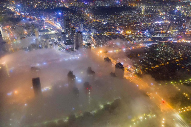 Buildings are shrouded in advection fog at West Coast New Area on June 15, 2020 in Qingdao, Shandong Province of China. (Photo by Han Jiajun/VCG via Getty Images)