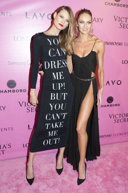 Models Behati Prinsloo and Candice Swanepoel attend the after party for the 2012 Victoria's Secret Fashion Show at Lavo NYC on November 7, 2012 in New York City. (Photo by Jim Spellman/WireImage)