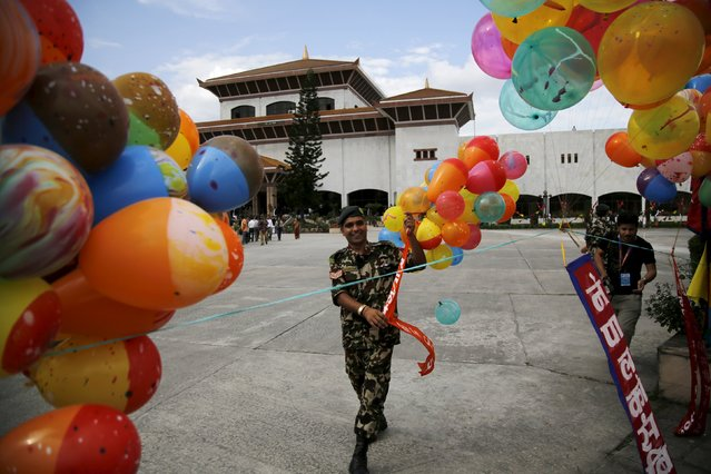 A Nepalese army personnel decorates the premises of the parliament before President Ram Baran Yadav formally promulgates the new constitution in Kathmandu, Nepal September 20, 2015. (Photo by Navesh Chitrakar/Reuters)