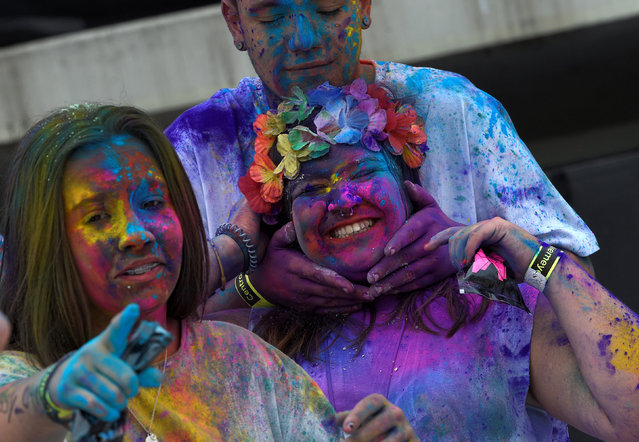 Revellers take part in the Holi Party Festival at Niemeyer Center in Aviles, northern Spain, August 27, 2016. (Photo by Eloy Alonso/Reuters)