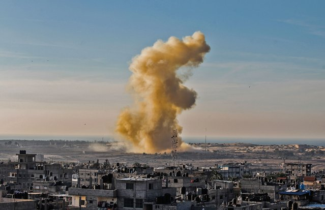 A picture taken on November 28, 2017 from Rafah in the southern Gaza Strip shows smoke billowing following an explosion close to the border on the Egyptian side of the divided city. Egypt's years-long military campaign against a jihadist insurgency in the north of the Sinai Peninsula is under increasing scrutiny following a devastating mosque attack last week in which more than 300 people were killed – the deadliest in the country's recent history – highlighting the insurgents' ability to carry out spectacular attacks despite the deployment of tens of thousands of troops. The Egyptian military has largely ended the once-lucrative smuggling trade with the Gaza Strip by destroying tunnels under the border with the Palestinian territory and razing parts of the divided frontier town of Rafah to create a buffer zone. (Photo by Said Khatib/AFP Photo)