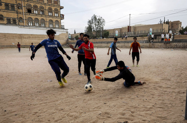 Yemeni youth take part in a football match despite the threats of the ongoing coronavirus COVID-19 pandemic in Sanaa, Yemen, 02 June 2020. Schools and universities have been closed down across Yemen as part of measures to stem the widespread of the pandemic COVID-19 disease caused by the SARS-CoV-2 coronavirus. (Photo by Yahya Arhab/EPA/EFE/Rex Features/Shutterstock)