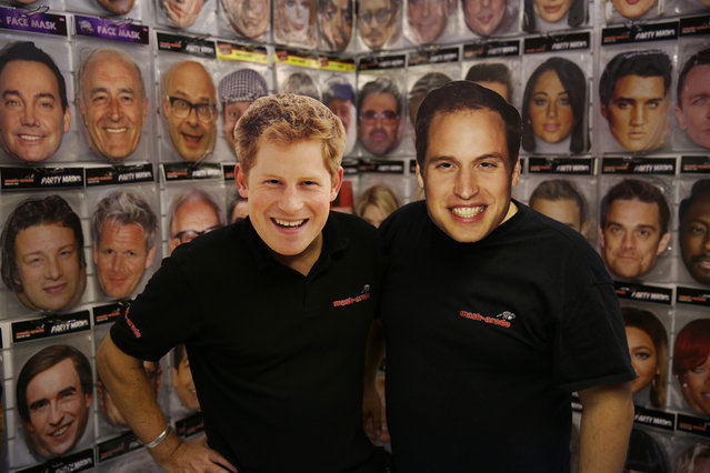 Salesman wear Prince Harry and Prince William masks  at The Ideal Home Christmas Show in London, England, November 14, 2012. Over 400 exhibitors are showcasing a range of gift ideas for Christmas at the Earls Court exhibition centre. (Photo by Peter Macdiarmid)