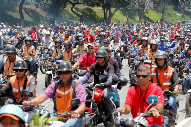 Government supporters ride their motorcycles in support of Venezuela's President Nicolas Maduro in Caracas, Venezuela, September 1, 2016. (Photo by Christian Veron/Reuters)