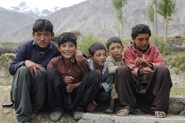Pakistani boys pose for a picture in the remote mountain village of Askole in the Karakoram mountain range in Pakistan September 11, 2014. The number of expeditions has dwindled, wrecking communities dependant on climbing for income and starving Pakistan's suffering economy of much-needed dollars. (Photo by Wolfgang Rattay/Reuters)