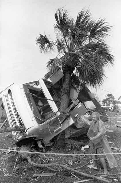 """Helen Walz stands next to the family motor home in her side yard in Venice, Florida on Sunday, March 17, 1985, after a tornado swept through the neighborhood damaging homes and business, killing two people and injuring about 40. Walz said her husband was """"working on the motor home until 10 at night, but look at it now"""". (Photo by Joe Skipper/AP Photo)"""