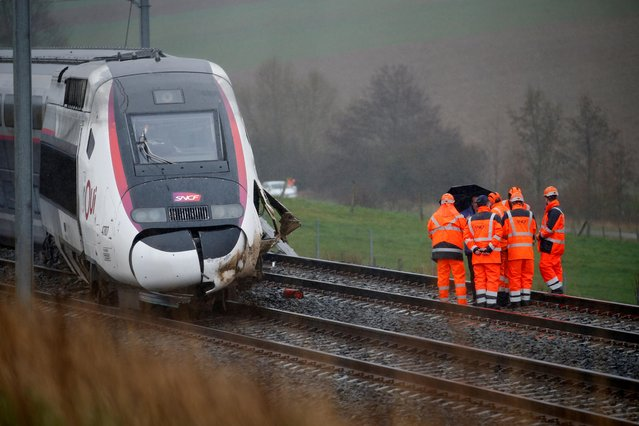 Employees work on the site of a derailed high-speed TGV train operated by state-owned railway company SNCF in Ingenheim, near Strasbourg, France, March 5, 2020. (Photo by Pascal Rossignol/Reuters)