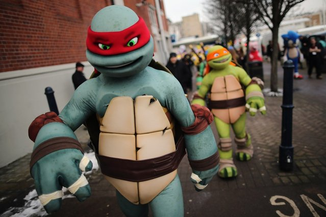Life size Teenage Mutant Ninja Turtles cartoon characters are led outside for a photocall during the 2013 London Toy Fair at Olympia Exhibition Centre on January 22, 2013 in London, England. The annual fair which is organised by the British Toy and Hobby Association, brings together toy manufacturers and retailers from around the world.  (Photo by Dan Kitwood)