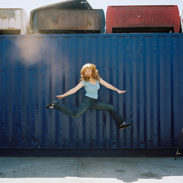"""Jumpology"". ""JUMP caitlin sold her car. It was totaled, so she sold it for $500 to a junk yard...then jumped"". LA, CA, USA. (Photo by Lauren Randolph)"