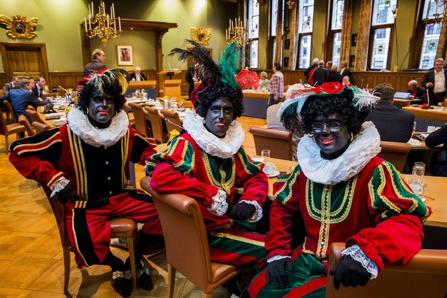 "(L-R) Dutch right wing PVV State members Ton van Kesteren, Matthijs Jansen and Dennis Ram attend a meeting in the Province House in Groningen, The Netherlands, November 5, 2014, dressed as ""Zwarte Piet"" (Black Pete) to make a statement that according to them ""Zwarte Piet"" should not change his appearance in the city of Groningen during the Sinterklaas (Saint Nicolas) festival. (Photo by Vincent Jannink/EPA)"