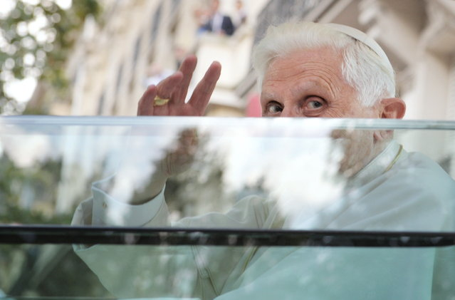 Pope Benedict XVI waves from the popemobile on his way for an evening prayer service at Notre Dame Cathedral on September 12, 2008 in Paris during his first visit to France. Pope Benedict XVI announced on February 11, 2013 he will resign on February 28, the first pontiff to step down in centuries. (Photo by Olivier Laban-Mattei/AFP Photo)