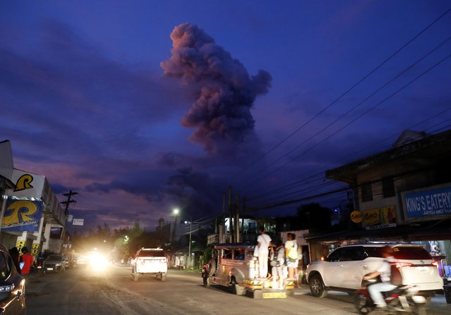 "A view of Mayon Volcano erupts anew in the town of Daraga, Albay province, Philippines, 24 January 2018. Mayon volcano located in eastern Philippines and active over the last 10 days spewed fresh lava and ash in two new eruptions a day earlier. The number of evacuees exceeded 60 thousand in the face of the threat of an even more potent explosion. The Philippines, which currently has 23 active volcanoes, is situated on the so-called ""Pacific Ring of Fire"", an area known for its intense seismic activity which extends from the west coast of the American continent to New Zealand, Japan, the Philippines and Indonesia. (Photo by Francis R. Malasig/EPA/EFE/Shutterstock)"
