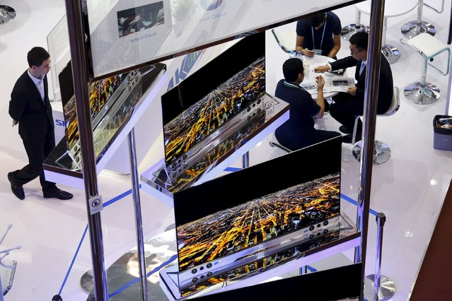 Slim television panels are displayed at a booth during the China Import and Export Fair, also known as Canton Fair, in the southern Chinese city of Guangzhou October 15, 2015. (Photo by Bobby Yip/Reuters)