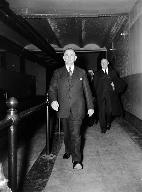 """Senate Majority Leader takes a walk. Washington, D.C., Nov. 15. Senate Majority Leader Alvin W. Barkley prefers to walk thru the Senate subway instead of using the tram car on his way to the opening of the special session on November 15, 1937"". (Photo by Harris & Ewing Collection)"