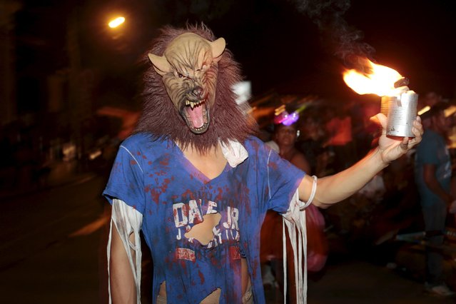 A reveller takes part in the popular annual Aguizotes festival in the indigenous community of Monimbo in Masaya, Nicaragua, October 23, 2015. During the festival, residents dress up in costumes of ghosts and other spirits of the dead from Nicaraguan myths and legends. (Photo by Oswaldo Rivas/Reuters)