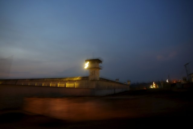 """Lights shine over a complex of ten prisons along """"Penal Road"""" in Porto Velho, the capital of the Brazilian state of Rondonia, August 28, 2015. (Photo by Nacho Doce/Reuters)"""