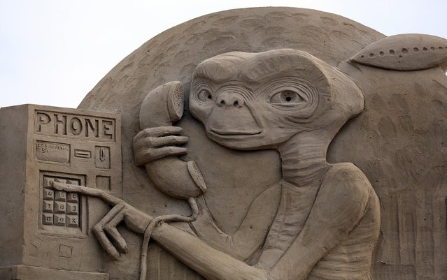 Detail of a sand sculpture of E.T. is seen as pieces are prepared as part of this year's Hollywood themed annual Weston-super-Mare Sand Sculpture festival on March 26, 2013 in Weston-Super-Mare, England. Due to open on Good Friday, currently twenty award winning sand sculptors from across the globe are working to create sand sculptures including Harry Potter, Marilyn Monroe and characters from the Star Wars films as part of the town's very own movie themed festival on the beach.  (Photo by Matt Cardy)