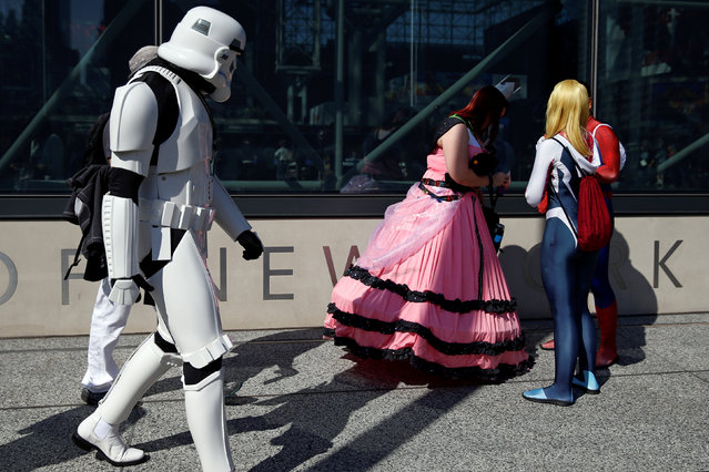 People dressed in costume are seen outside the New York Comic Con in New York, U.S., October 6, 2016. (Photo by Shannon Stapleton/Reuters)