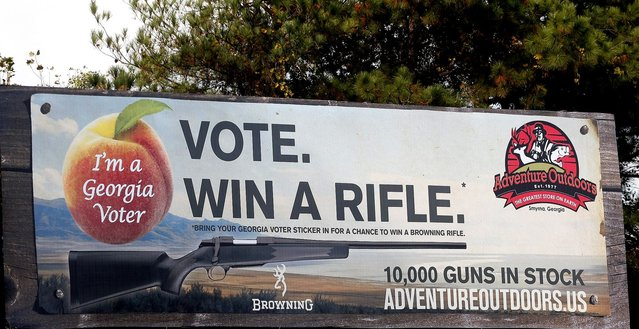 "One of several billboards of a gun raffle promotion at Adventures Outdoors in Smyrna, Georgia, October 25, 2012. The store has promoted the raffle on billboards as a ""Vote. Win a rifle"". but owner Jay Wallace has stated that all Georgia residents are eligible to enter. (Photo by Tami Chappell/Reuters)"