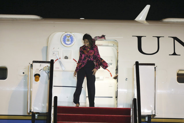 U.S. First Lady Michelle Obama arrives at the Hamad Airport in Doha, Qatar, Monday, November 2, 2015. She'll visit the al-Udeid air base with comedian Conan O'Brien. She is also scheduled to give a speech Wednesday on her Let Girls Learn initiative at the 2015 World Innovation Summit for Education, sponsored by the Qatar Foundation. (Photo by Osama Faisal/AP Photo)