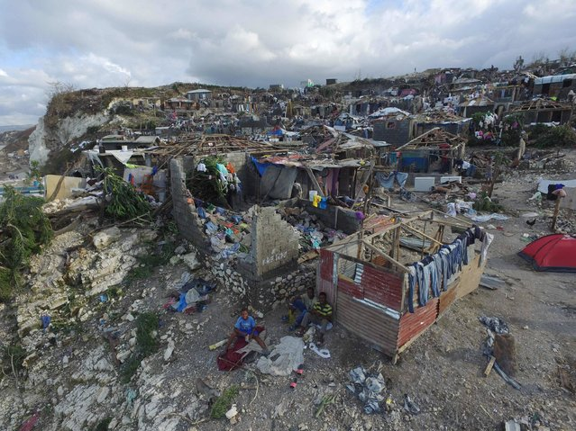 Homes destroyed and damaged by Hurricane Matthew are seen in Jeremie, in western Haiti, on October 7, 2016. The full scale of the devastation in hurricane-hit rural Haiti became clear as the death toll surged over 400, three days after Hurricane Matthew leveled huge swaths of the country's south. (Photo by Nicolas Garcia/AFP Photo)
