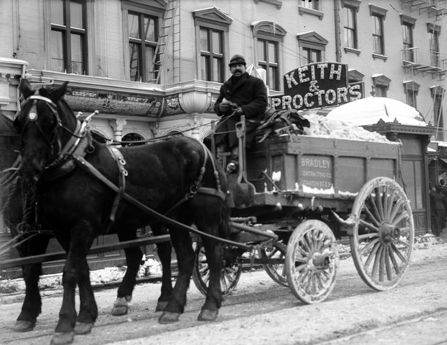 Cleaning snow from streets in trucks. New York, January1908. (Photo by George Grantham Bain)