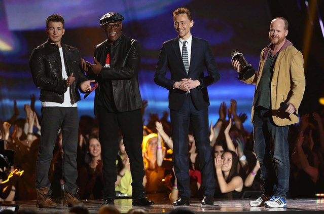 "Chris Evans, Samuel L. Jackson, Tom Hiddleston and Joss Whedon accept the award for movie of the year for ""Marvel's The Avengers"". (Photo by Matt Sayles/Invision)"