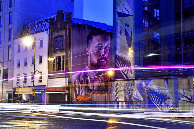"A mural by the artist ""Smug One"" known locally as the chef and the lobster looms large on March 1, 2018 in Belfast, Northern Ireland. The striking piece is one of many art installations that are changing the visual landscape of a city long associated with divisive mural commentary. (Photo by Charles McQuillan/Getty Images)"