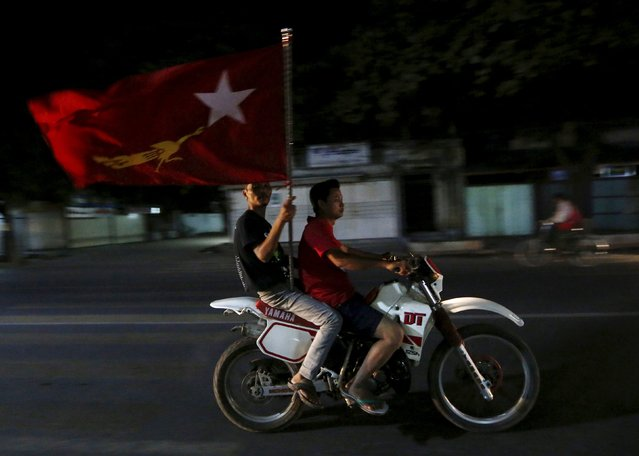Supporters of opposition leader Aung San Suu Kyi carry a National League for Democracy (NLD) flag through the streets of Mandalay, Myanmar, November 9, 2015. (Photo by Olivia Harris/Reuters)