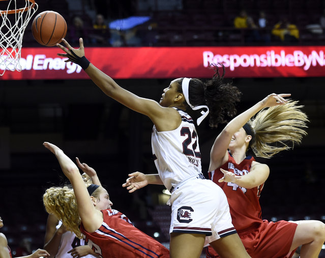 South Carolina forward A'ja Wilson (22) shoots over Liberty center Ashley Rininger, left, and forward Catherine Kearney (44) of an NCAA college basketball game Sunday, December 21, 2014, in Minneapolis. South Carolina won 84-44. (Photo by Hannah Foslien/AP Photo)