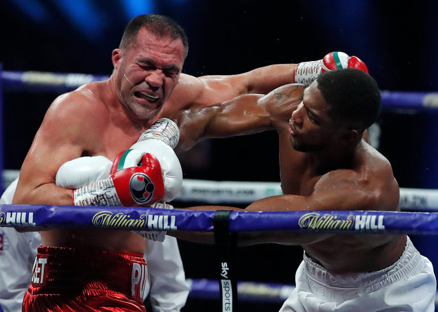 Anthony Joshua punches Kubrat Pulev during the IBF, WBA, WBO and IBO World Heayweight Title fight between Anthony Joshua and Kubrat Pulev at The SSE Arena, Wembley on December 12, 2020 in London, England. A limited number of fans (1000) are welcomed back to sporting venues to watch elite sport across England. This was following easing of restrictions on spectators in tiers one and two areas only. (Photo by Andrew Couldridge – Pool/Getty Images)