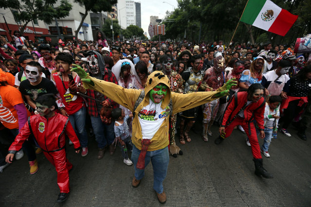 People dressed as zombies participate in a Zombie Walk procession in Mexico City, Mexico, October 22, 2016. (Photo by Edgard Garrido/Reuters)