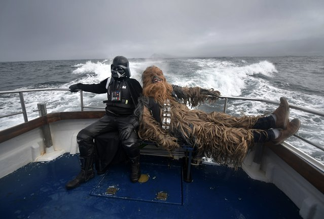 Fans dressed as Darth Vader and Chewbacca take a boat trip to the Skelligs on May 4, 2018 in Portmagee, Ireland. (Photo by Charles McQuillan/Getty Images)